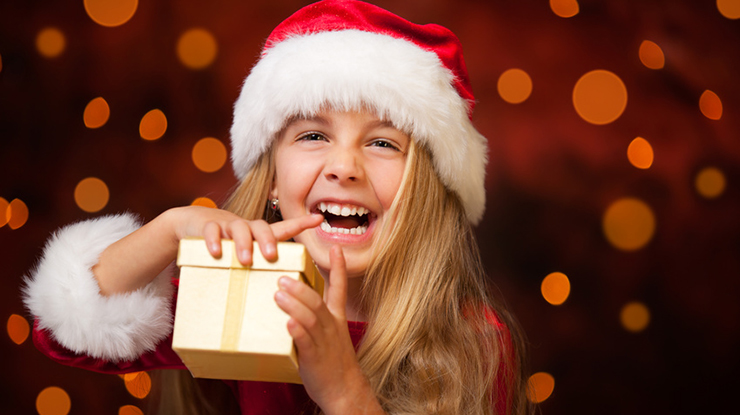 little miss santa is happy about a gift